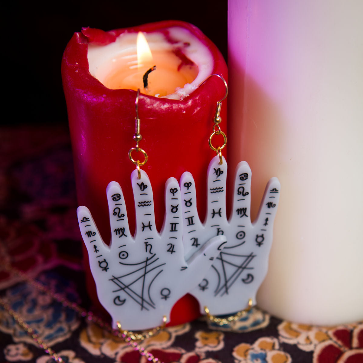 Sugar & Vice Palmistry Hand Earrings social media