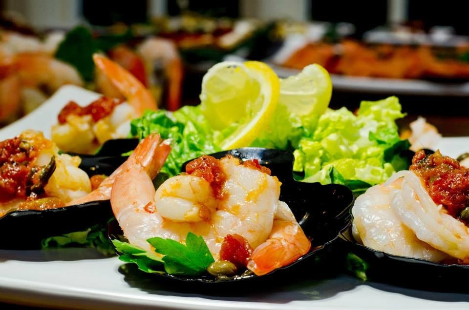 Carlsbad Caterers is a catering to go.  Order trays and platters for your event.  Appetizers, trays and platters.  Shrimp Cocktail with Tomato and Caper Sauce.  Shrimp Skewers with Tomato and Caper Sauce, Shrimp and Sausage Skewers, Shrimp over Endives