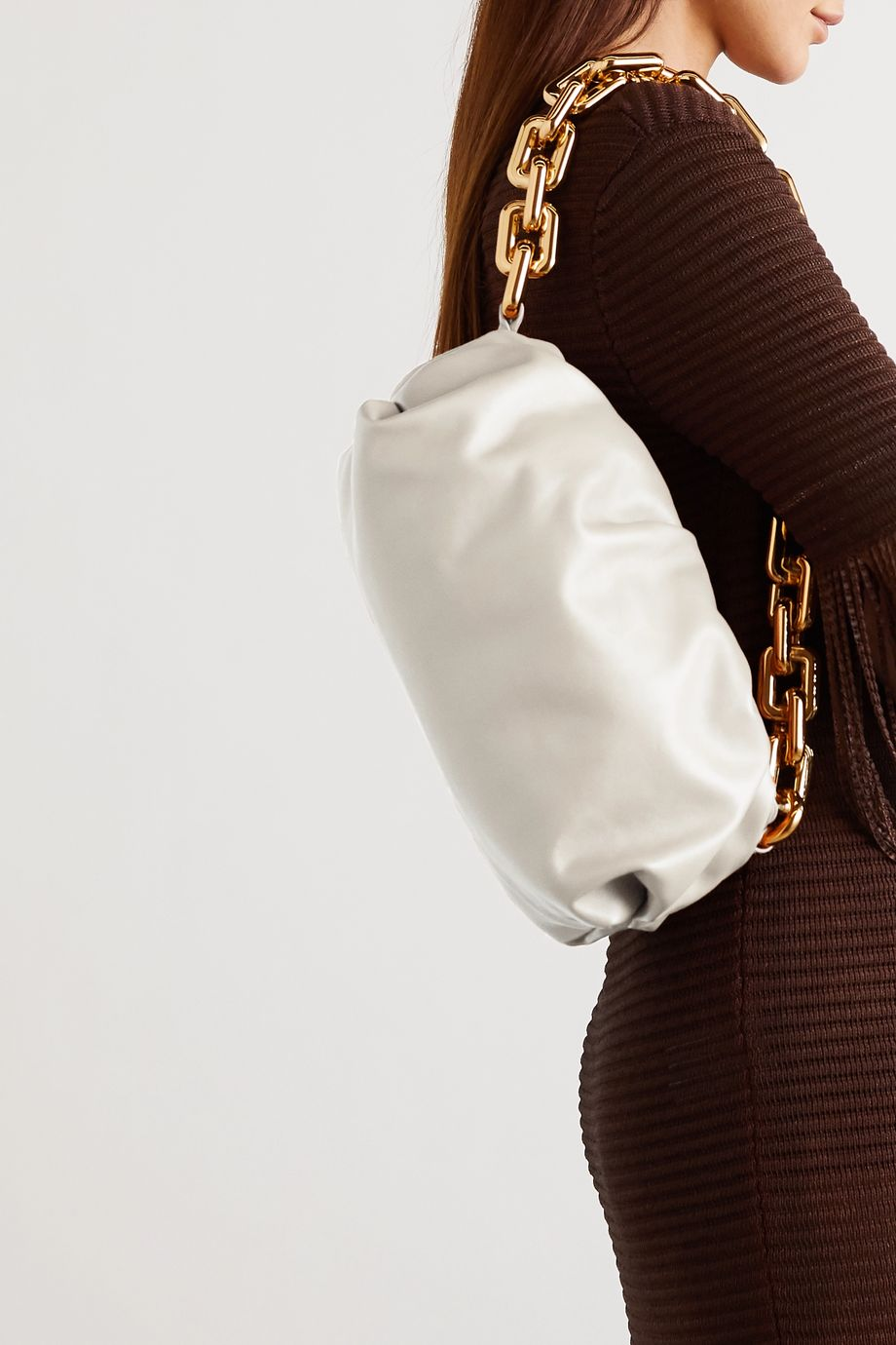 The Pouch chain-embellished gathered leather clutch