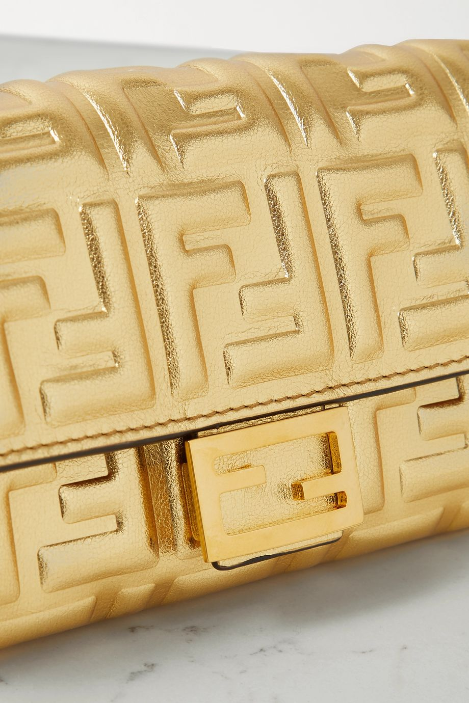 Baguette embossed metallic leather clutch