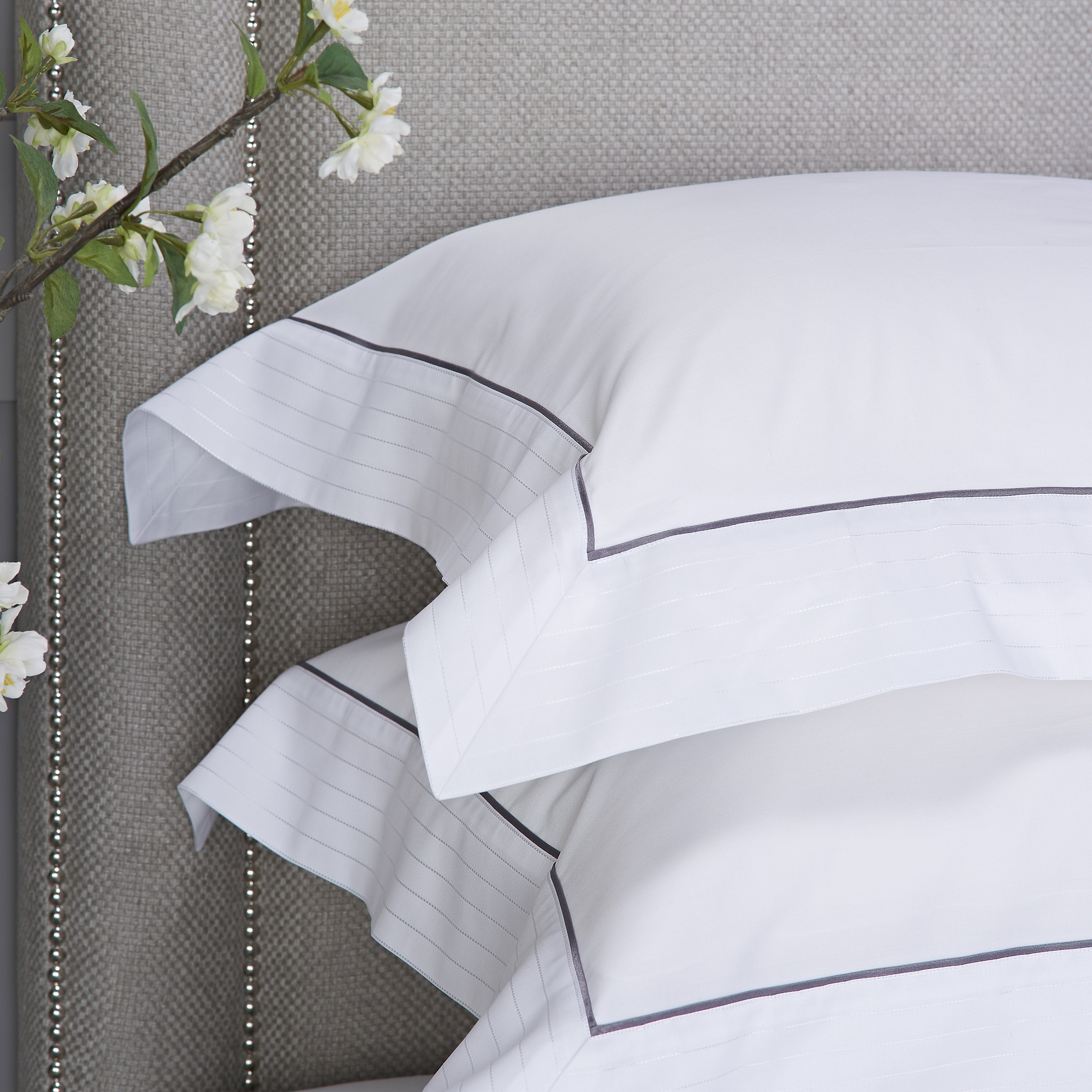 Heirlooms luxurious Sandringham cotton sateen white Oxford Pillowcase set with a contrast border whose subtle self colour woven stitch adds shien to your lines.