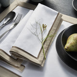 Provence table napkins is a contemporary design with a warm taupe cotton sateen border with satin piping in chocolate colour