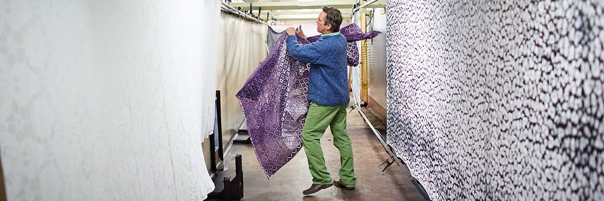 Kevin O'Brien making textiles by hand