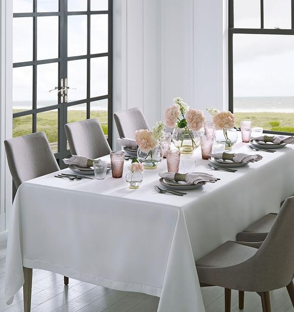 A SFERRA Festival tablecloth in classic white provides a stunning backdrop to a minimalist tabletop done in neutrals and pastels.