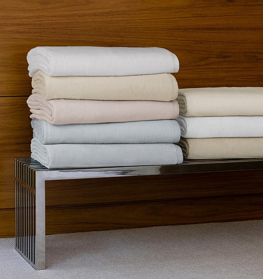 St. Moritz  plush, cotton blankets are available in White, Ivory, Pink, Blue, Snow and Mushroom