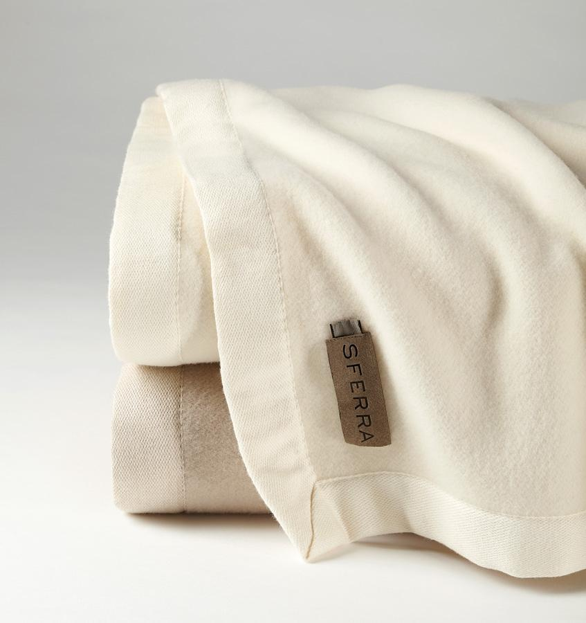 Olindo 100% Ultra-Fine Australian Merino Lambswool blanket available in Ivory and Sand