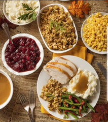 Turkey dinner with trimmings, cranberry jelly, stuffing, corn, mashed potatoes and gravy