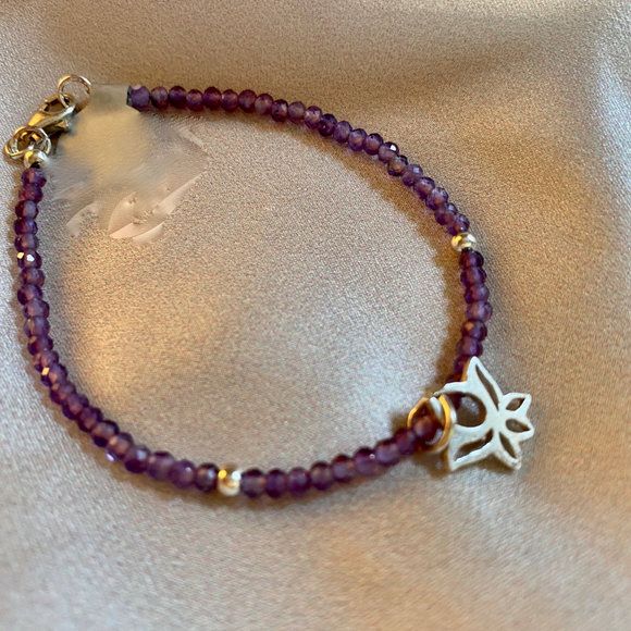 Amethyst bracelet with lotus charm