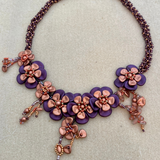 Floral 3D necklace with purple and copper coloured beads.  - SALE ITEM