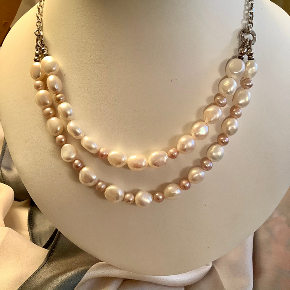 Pearl necklace and earring set. Double strand of  peach and white baroque pearls.