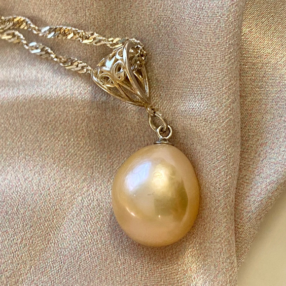 Large light peach coloured pearl on an intricate sterling silver chain
