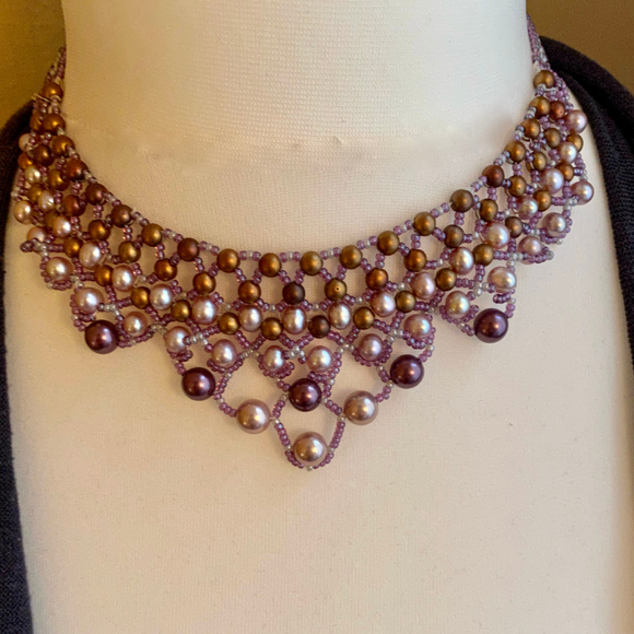 Cultured and faux pearl choker in lattice design finished with a sterling silver clasp.