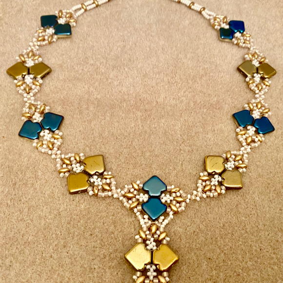 Reversible necklace with blue/cream/gold motifs