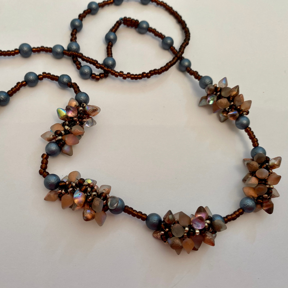 Long station necklace with spiky opalescent  beads 28