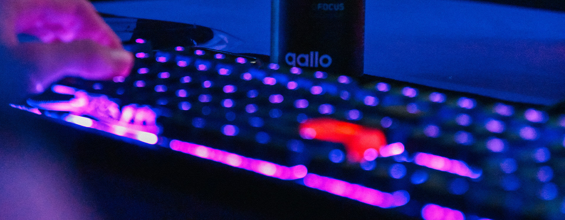 LED Gaming Keyboard With Qallo® QFocus Behind it.