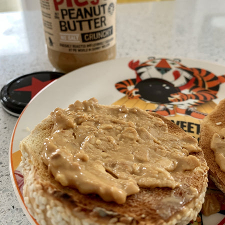 Pic's Peanut Butter Crunchy No Salt spread on a bagel for breakfast.