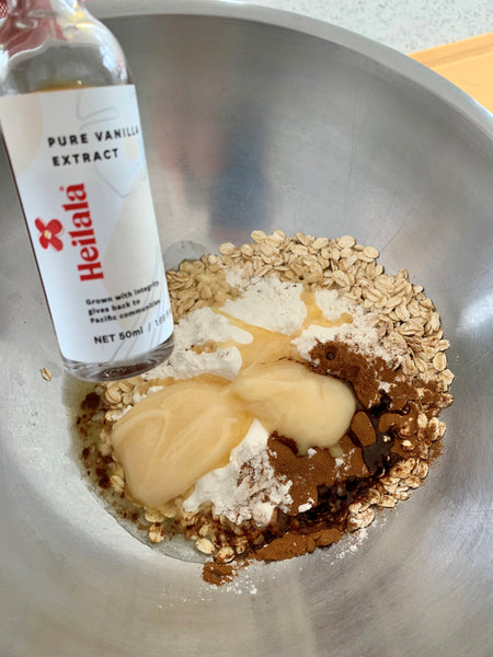 Heilala Pure Vanilla Extract mixing it into oatmeal cookies.