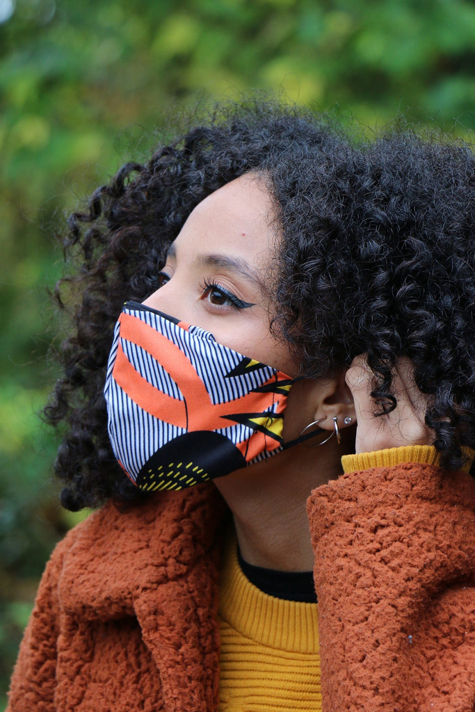 facemask mascarilla african inspired diaspora new york made in nyc tribal pink petals sky blue flower afromask afro buy black black owned covid mascarillas mascara loops adjustable nose bridge
