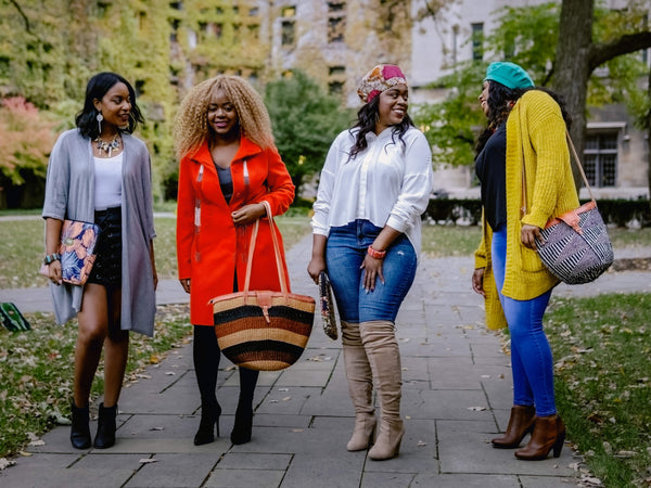 Black women wearing Ricafrica African accessories