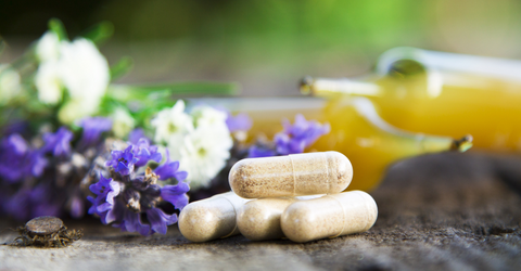 Supplements sit amongst flowers and herbs demonstrating the natural healthfulness Level Up provides