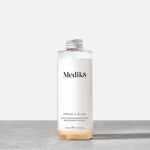 Press & Glow™ Refill by Medik8. A Daily Exfoliating PHA Tonic with Enzyme Activator.