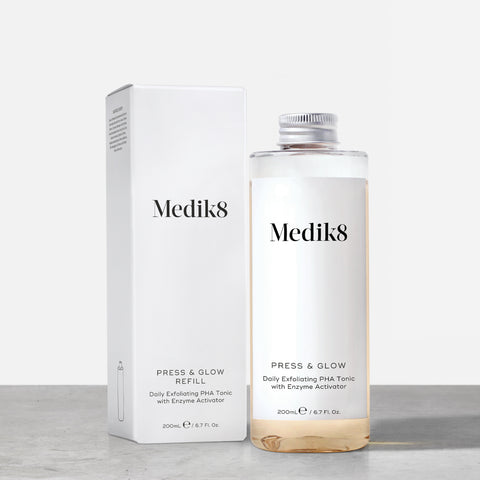 Press & Glow Refill™ by Medik8. A Daily Exfoliating PHA Tonic with Enzyme Activator.