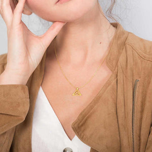 Yoga inspired gold necklace. The jewel represents the lotus flower position. Essential and geometric style. Sliding pendant.