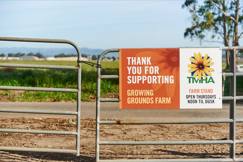 "sign hanging on a gate that reads ""thank you for supporting Growing Grounds Farm"""