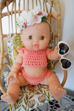 "Load image into Gallery viewer, BABY DOLL GIFT SET - ""Hibiscus Dream"" Paola Reina Bella baby doll dressed in boho crochet doll clothes crop top & bloomers with white framed heart sunglasses and flower crown."