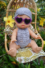 "Load image into Gallery viewer, BABY DOLL GIFT SET - "" Lilac Dream"" Paola Reina Bella baby doll dressed in boho crochet doll clothes jumpsuit with purple framed heart sunglasses and turban style bonnet."