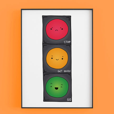Print of traffic light in red, amber ad green with faces. By Lucie Cooke Studio