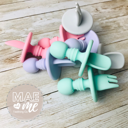 Silicone toddler spoon and fork set.