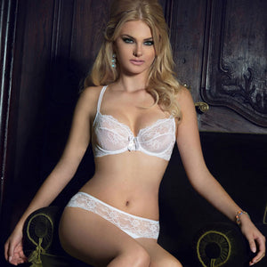 Pretty blonde woman sitting down wearing Roza Ofelia white bra and knickers