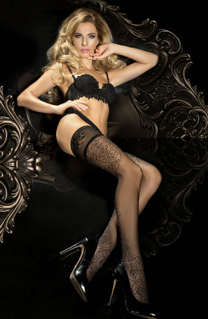 stunning blonde with long hair wearing black bra, black hold ups and stiletto heels on a chair