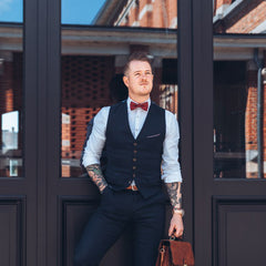 well dressed man with dark red cork bow tie