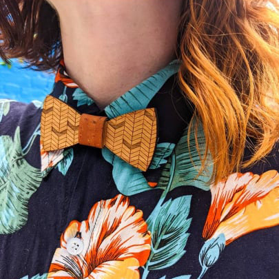 woman wearing engraved wooden bow tie