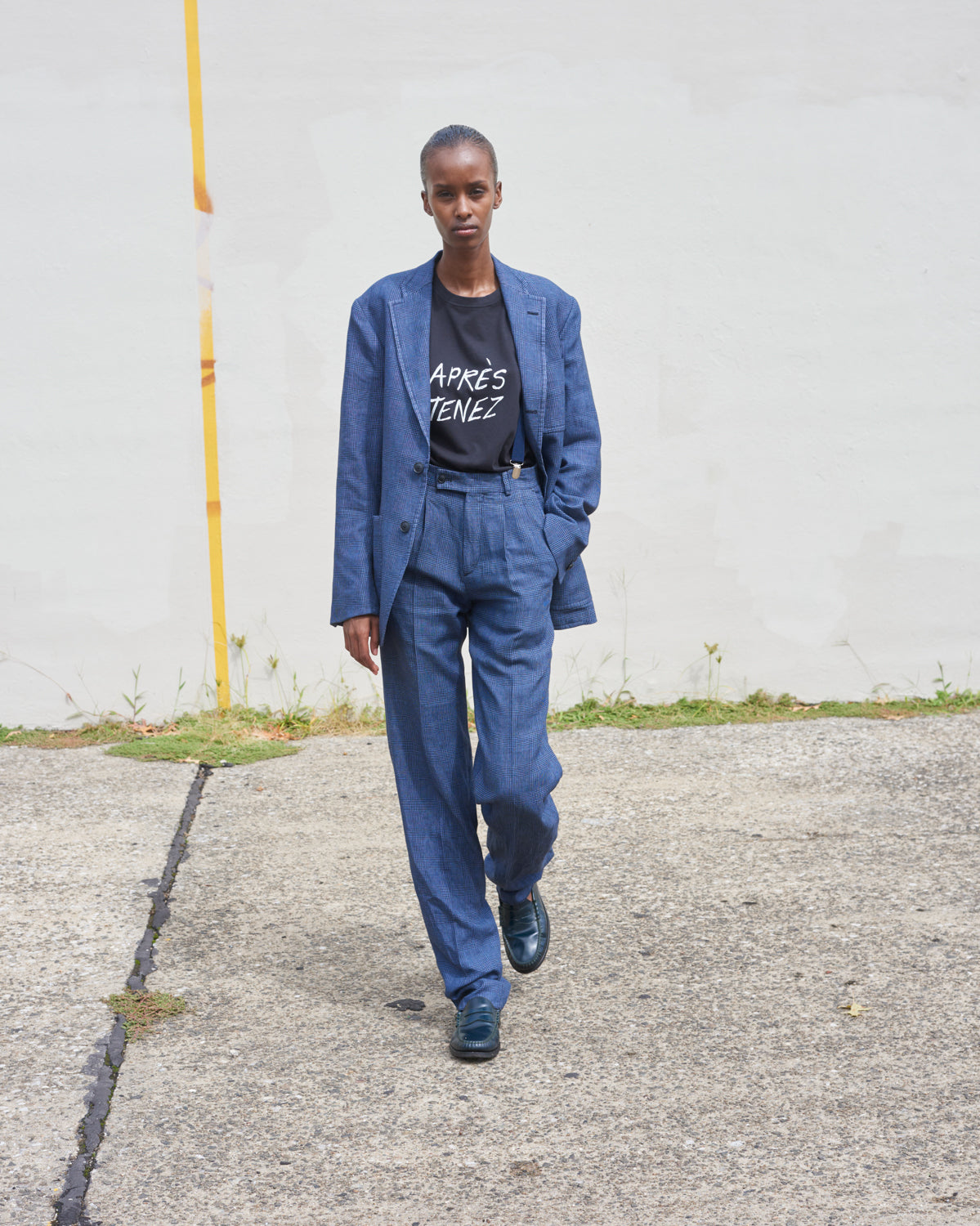 "Model wears The Academy New York SS21 Club Jacket and Double Pleat Pant in Overdyed Lilac.  She wears the black ""Apres Tenez"" t shirt underneath."