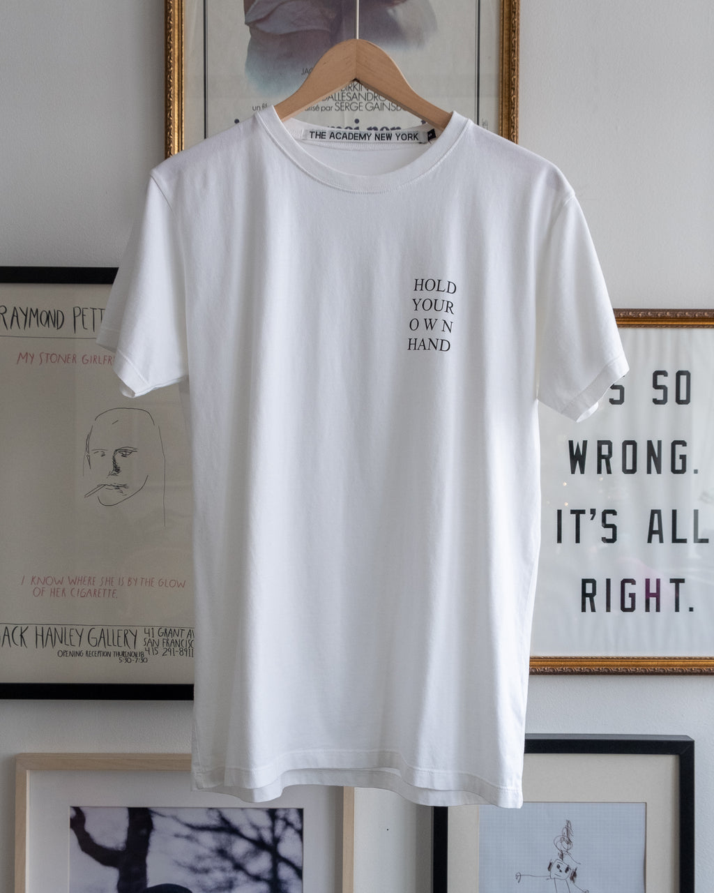 "The Academy New York white t shirt with ""hold your own hand"" printed."