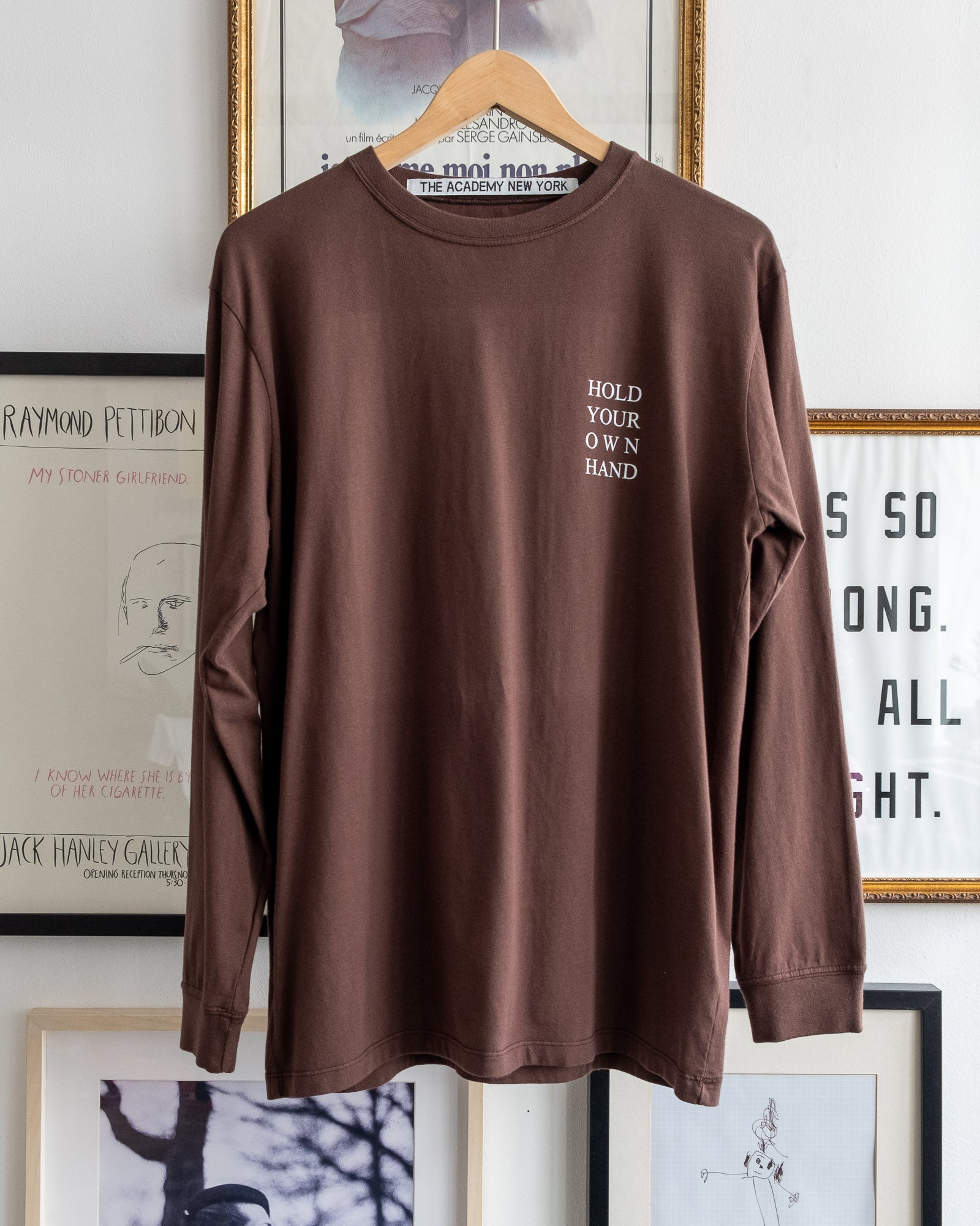 "The Academy New York Turkish coffee long sleeve t shirt with ""Hold Your Own Hand"" text. (front)"