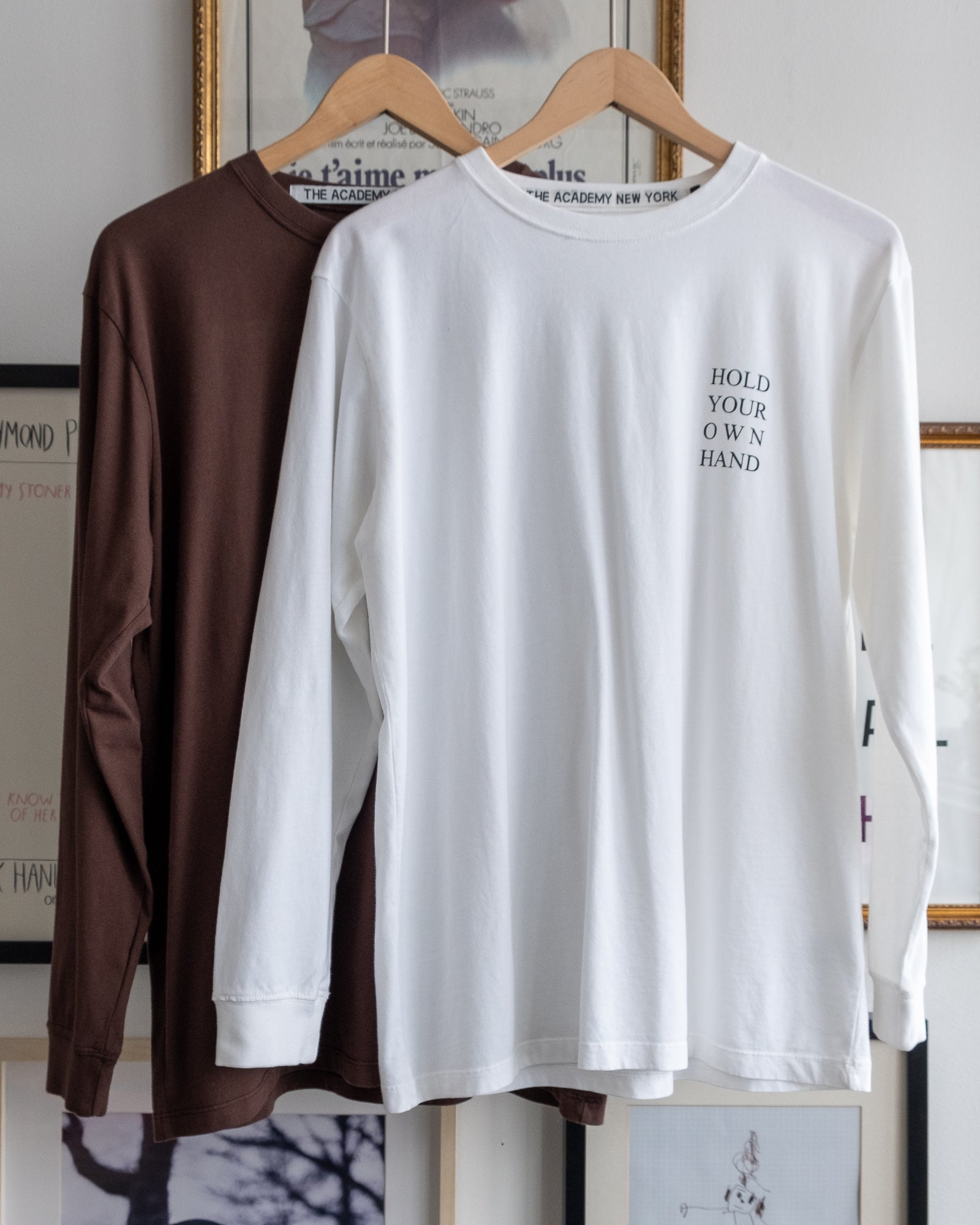 "The Academy New York Turkish coffee and white long sleeve t shirts with ""Hold Your Own Hand"" text."