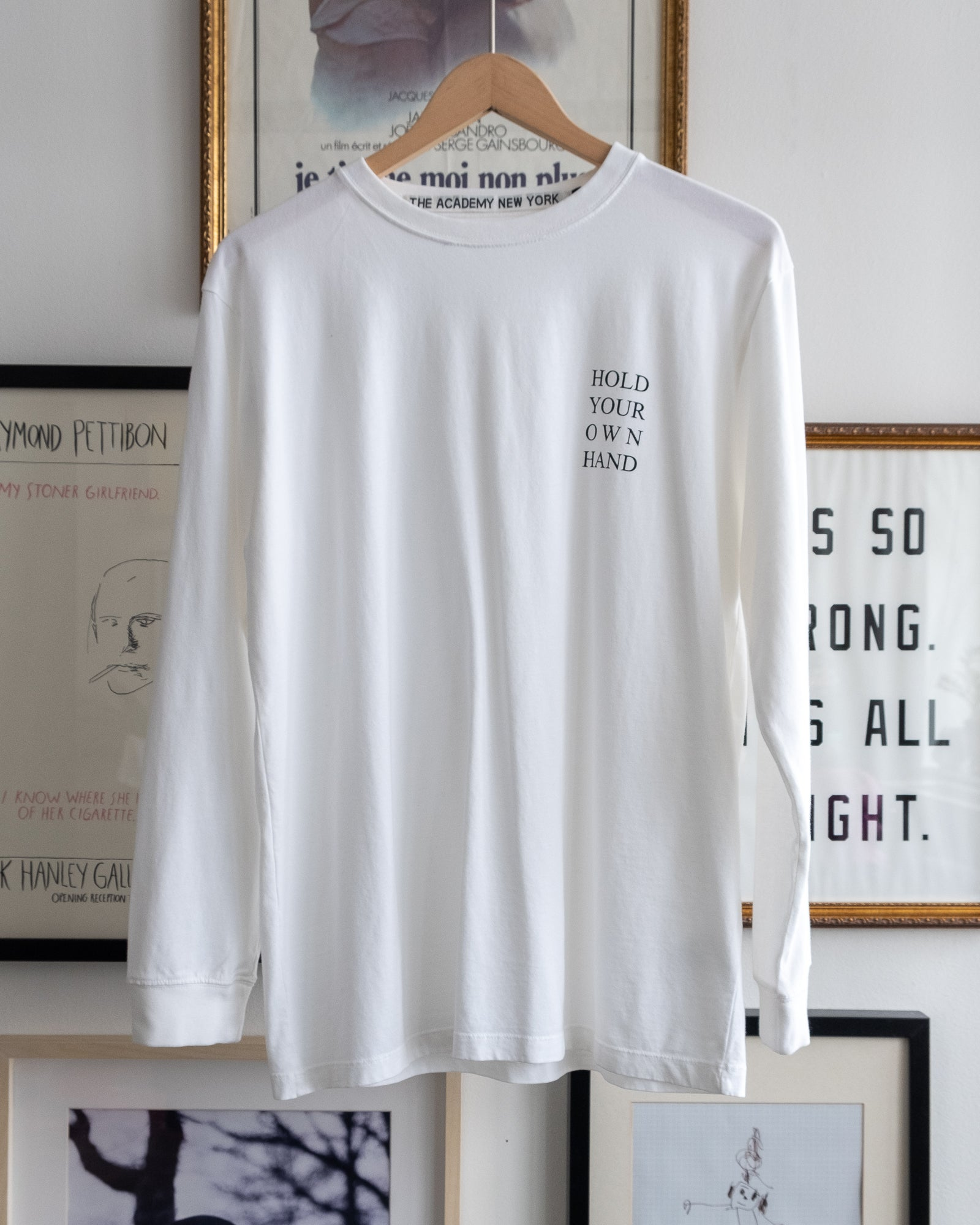 "The Academy New York white long sleeve t shirt with ""Hold Your Own Hand"" text. (front)"