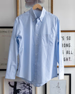 "Load image into Gallery viewer, The Academy New York. Classic Oxford blue button-down shirt in blue and white stripe, featuring ""T.A.N.Y."" embroidered on the left shoulder. (front)"