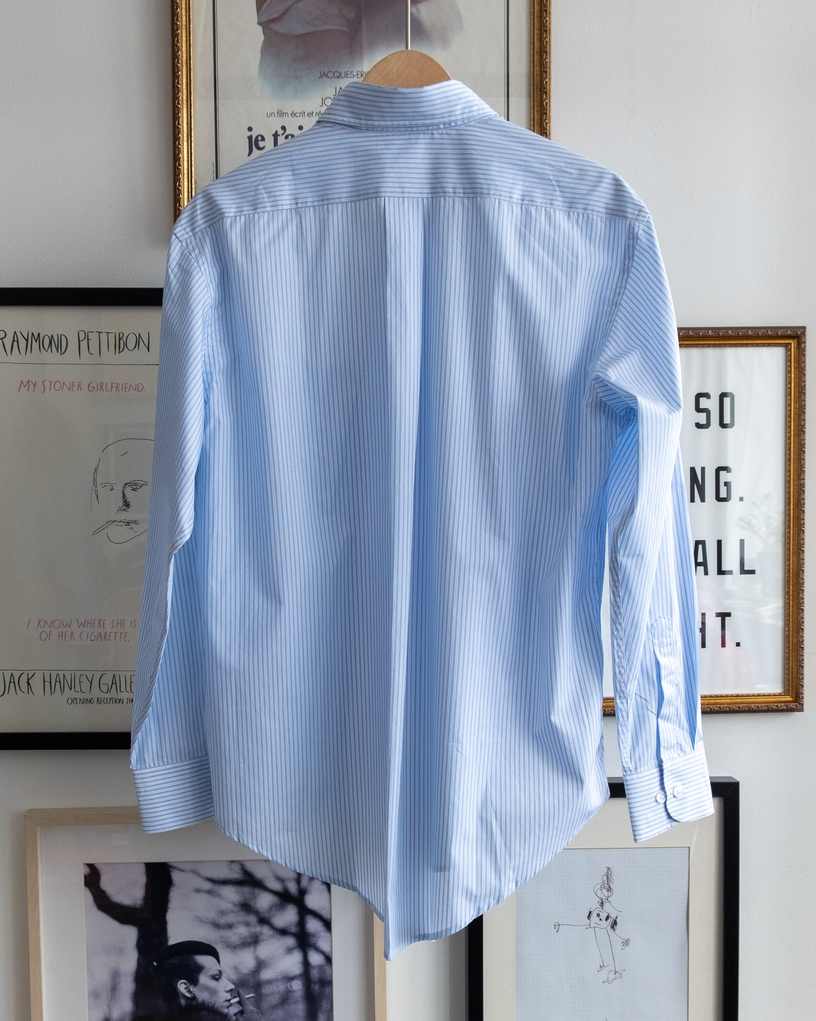 "The Academy New York. Classic Oxford blue button-down shirt in blue and white stripe, featuring ""T.A.N.Y."" embroidered on the left shoulder. (back)"