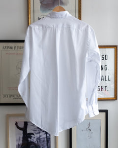 "The Academy New York. Classic Oxford blue button-down shirt in white, featuring ""T.A.N.Y."" embroidered on the left shoulder. (back)"