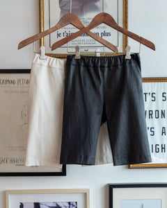 The Academy New York Biker Short in black and tan (front).