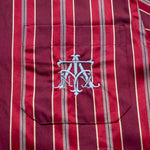 Load image into Gallery viewer, The Academy New York Crest PJ shirt in burgundy close up of blue embroidered crest.