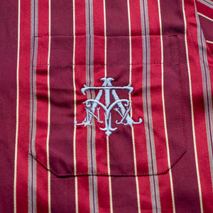 The Academy New York Crest PJ shirt in burgundy close up of blue embroidered crest.