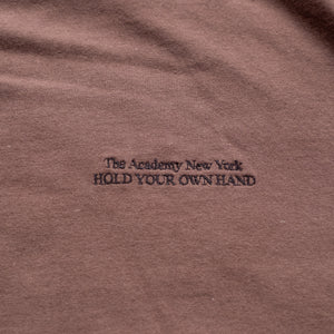 "Turkish coffee t shirt with black embroidered ""The Academy New York Hold Your Own Hand"" text."
