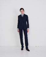 Load image into Gallery viewer, Model wears The Academy New York Double Breasted Dinner Jacket and double pleat pant  in Navy Glen Plaid.
