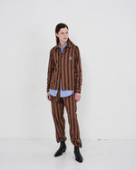 Load image into Gallery viewer, Model wears The Academy New York Crest PJ Shirt and PJ Pant in brown/blue stripe.